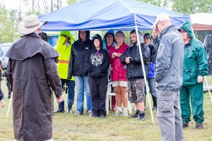 Staying dry during the judge's briefing.  Photo by Joan Morgan